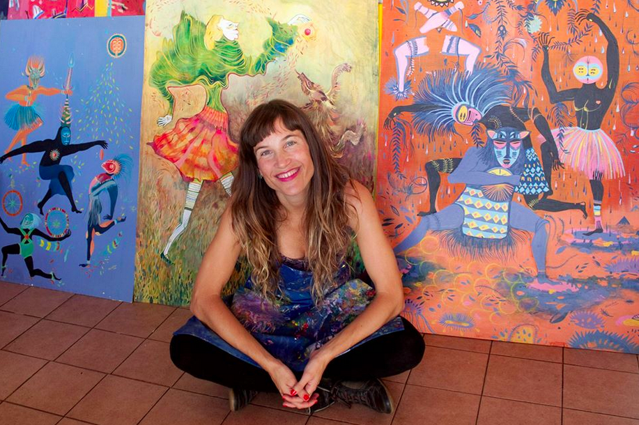 estela-cuadro-in-front-of-her-artwork